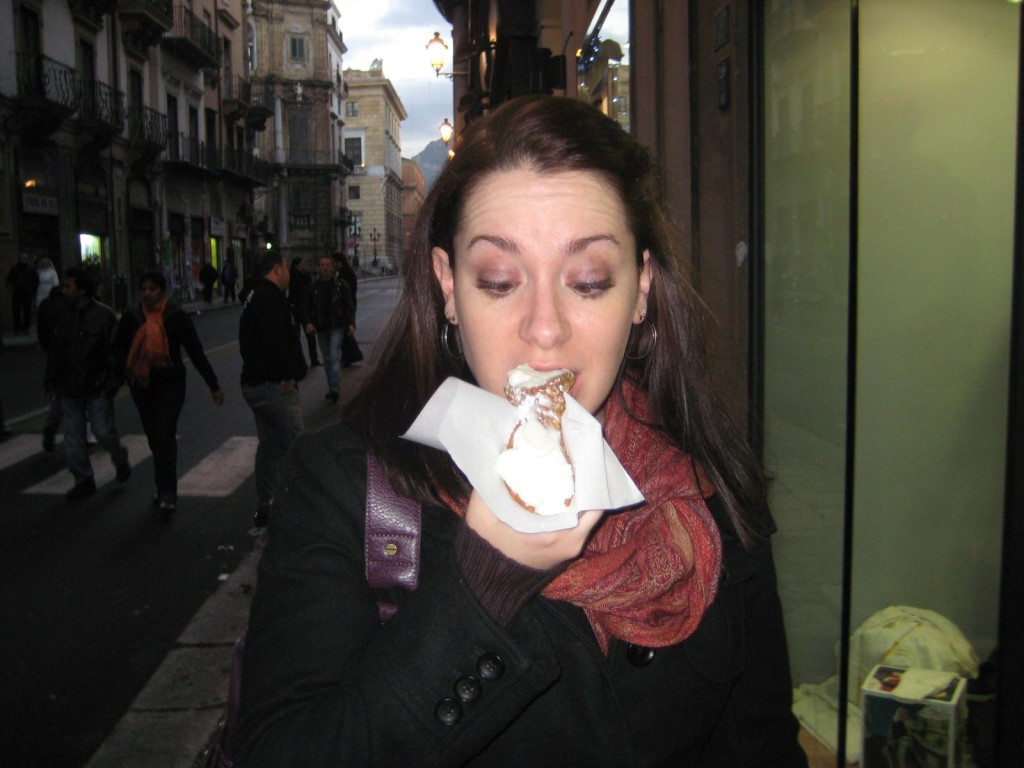 Eating cannoli in Palermo Sicily Italy