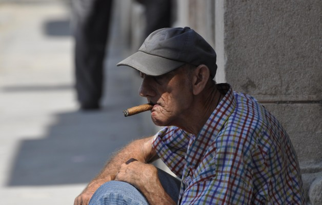 Man Smoking Cigar in Havana Cuba