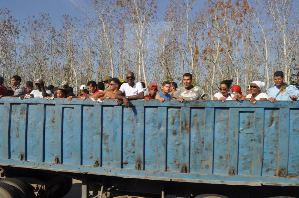 Cubans in dump truck heading to work