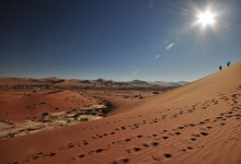 Hikers climb up Sossusvlei Dunes Namibia