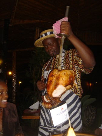 Slicing off a piece of heaven at Carnivore Restaurant in Nairobi Kenya where meats are paraded around on swords for the taking