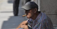 The secret to this man's saggy creased skin and bloody face?  The finest cigars money can buy - Cubans!