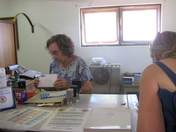 HRH Princess Shirley busy in the Hutt River central post office arranging our passport stamps and currency conversions