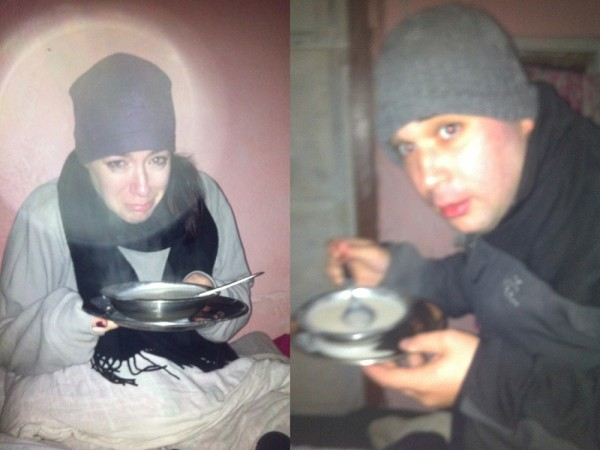 Freezing cold in soaking wet clothes enjoying some dinner before bed.  In the pitch dark.