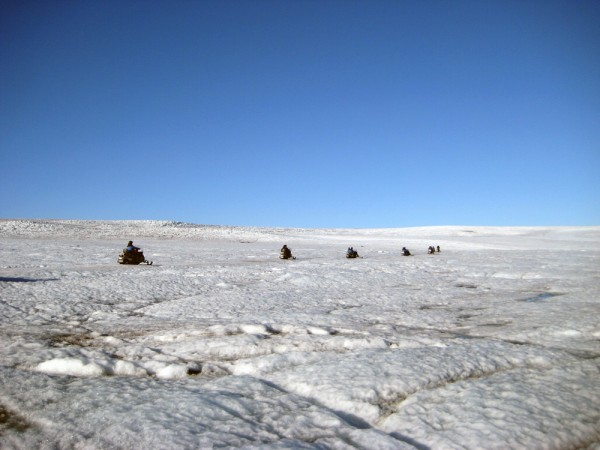 Snowmobiles make their way across the Langjökull Glacier