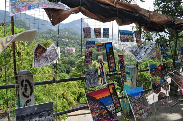 Favelas can be home to beautiful art - featuring paintings of favelas!