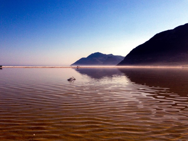 The mountains surrounding Cape Town reflecting in the shallow waters of Nordhoek beach