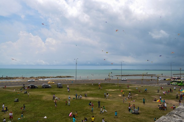 Ooooo, scary dangerous Colombia!  Complete with 200 children flying kites.
