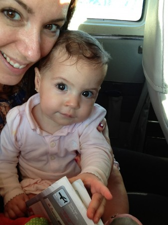 A small plane for a little lady.  Samara consults the flight safety card before takeoff.