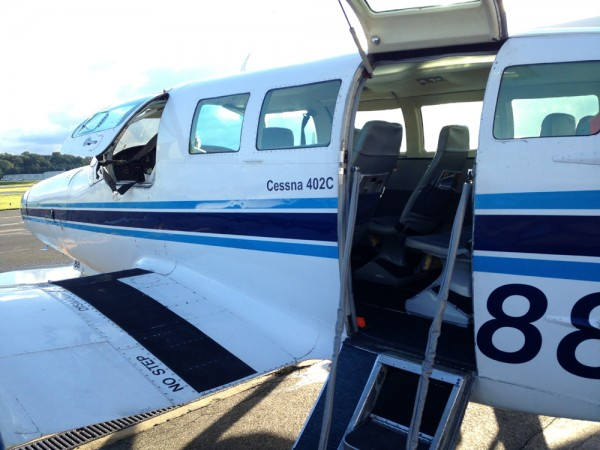 Climb aboard the Cessna 402C.  No stair car needed.