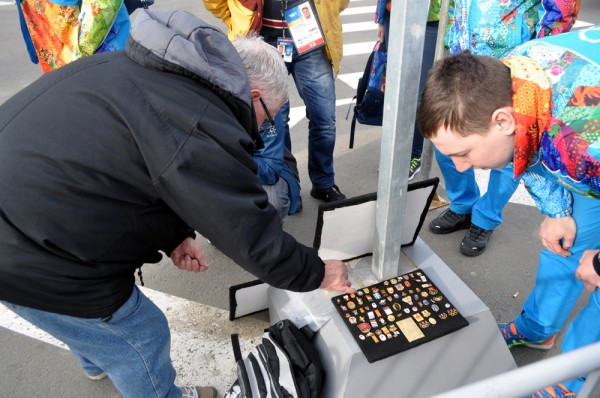 Pin trading taking place on the street outside the Main Press Center in Sochi