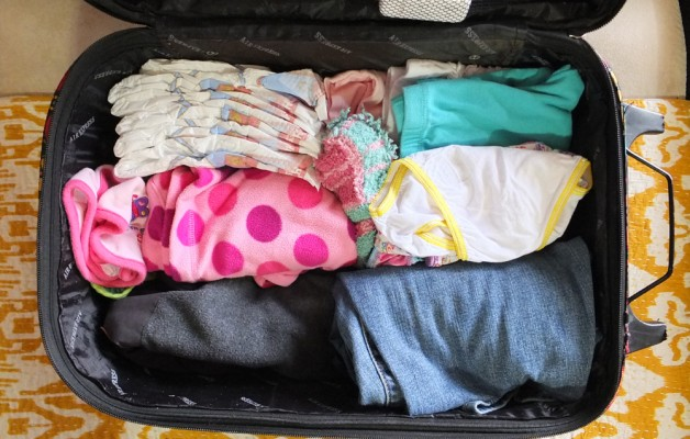 Extra clothes should be in the carry-on, just in case