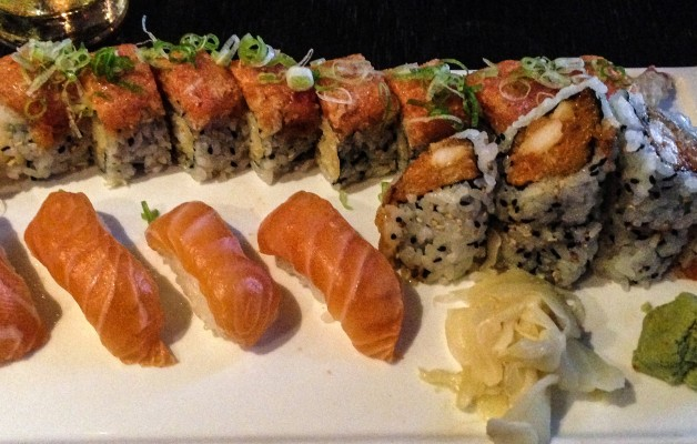 Traditional PRO in the back, four pieces of salmon nigiri and a spicy scallop crunch roll