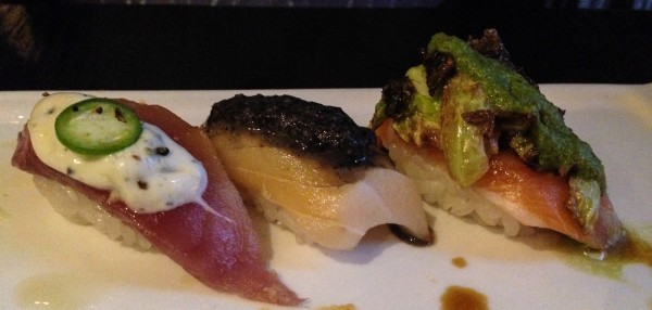 Three courses of Omakase sushi - Yogurt and jalapeno on tuna, balsamic on yellowtail and brussels sprout pesto on salmon