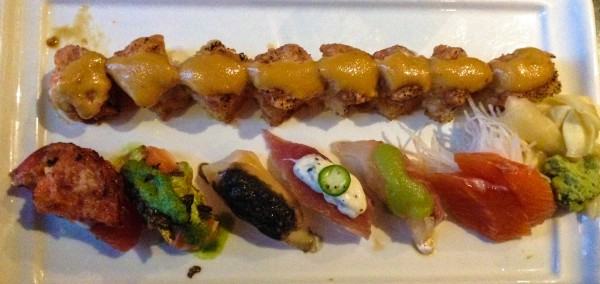 Tuna on crispy rice on top, five pieces of omakase sushi and two beautiful pieces of salmon sashimi on the right