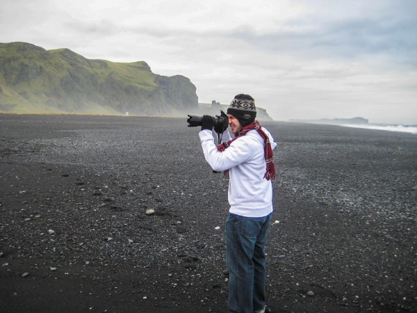 My brother snapping some photos on Vik;s stunning black sand beach.