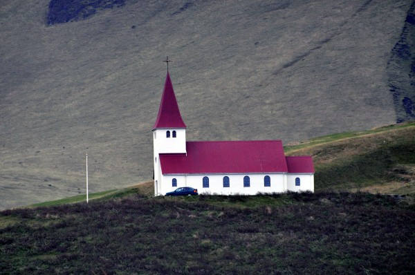 The tiny church on a hill that marks the beginning of the town of Vik