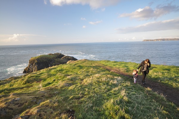 Chandra walking with our daughter on Carrickarede  Island.