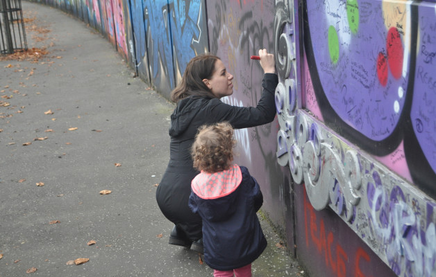 Chandra Signs Peace Wall with Samara