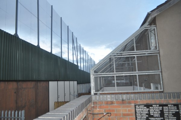 Fenced Homes Against Peace Wall in Belfast