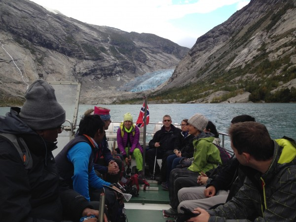 Crossing the glacial lake by boat before setting out on our trek.