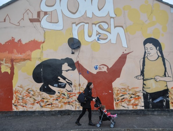 Samara & Chandra Walk with Gold Rush Mural